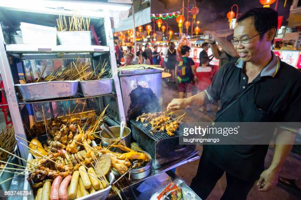 street food chinese new year chew jetty kongsi penang malaysia - george town penang stock photos and pictures