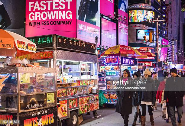 Street food in New York City Mobile food carts lined up to sell delicious and wide range of items like hot dogs pretzel Italian sausage kebabs etc...