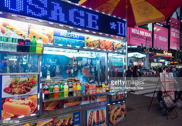 Street food in New York City Mobile food carts selling delicious and wide range of items like hot dogs pretzel Italian sausage kebabs etc Street food...
