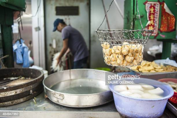 Street food is seen in the Central district of Hong Kong on September 8 2014 Pineapple buns and dumplings have been pulled from the shelves in Hong...