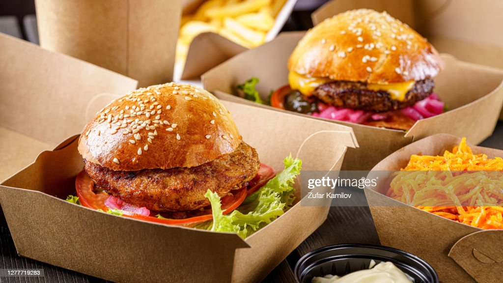 Street food. Meat cutlet burgers are in paper boxes. Food delivery. : Stock Photo