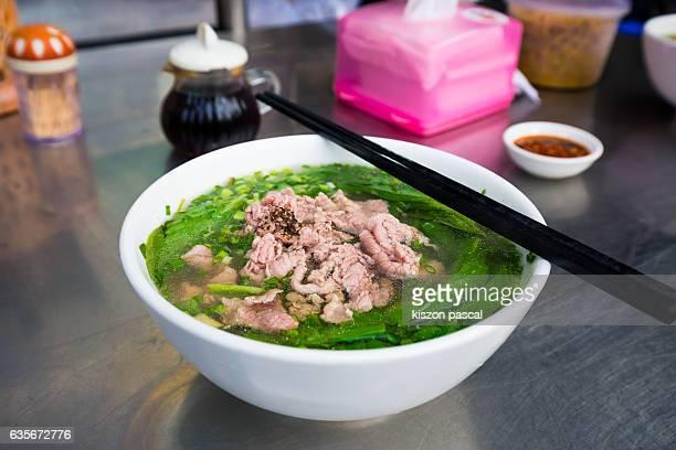 Street food , Pho bo ( beef noodle soup ), vietnam