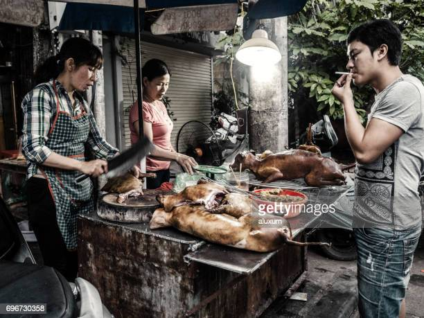 street food stall selling cooked dog meat - dead dog stock pictures, royalty-free photos & images