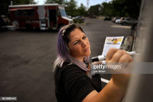 Street Food Truck coowner and driver Amy Crowfoot finishing out the menu and adding the days specials to the Caribbean Flavors menu at DTC EATS Food...