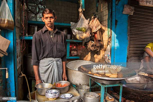 Street Food Vendor cooking and selling food stuff