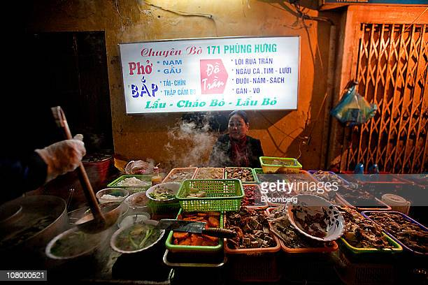A street food vendor sells Pho and various other dishes in Hanoi Vietnam on Tuesday Jan 11 2011 Vietnam starts eight days of meetings today that will...