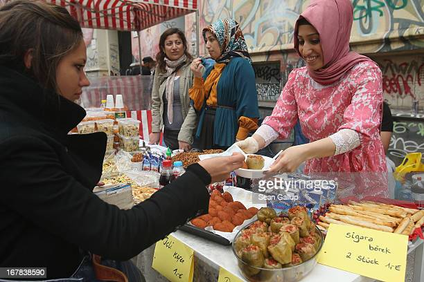 Street food vendors sell Turkish food at the MyFest street food and music fest in immigrantheavy Kreuzberg district on May Day on May 1 2013 in...