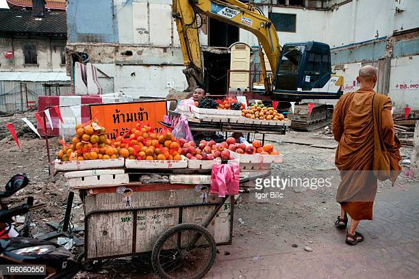 CONTENT] Street fruit stalls by a dusty building site at the back of Yaowarat Road in Chinatown Bangkok Thailand