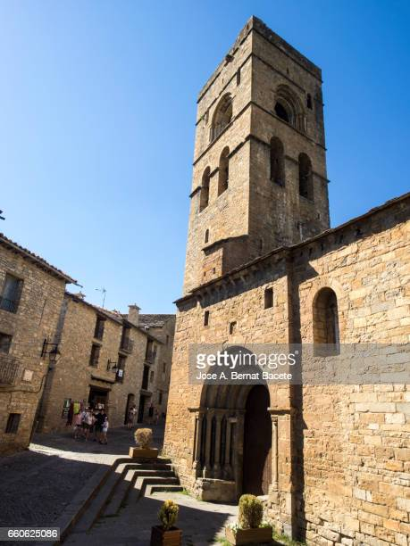 Street, gate and tower of the medieval church of Santa María de Aínsa