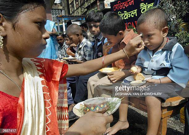 A street girl puts a religious marking on the forehead of a street child along with others as a part of 'Bhai phonta' in Calcutta 27 October 2003...