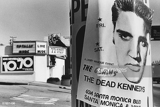 Street graffiti created with posters of a 1979 Dead Kennedys concert adorns a Sunset Boulevard light post in West Hollywood California