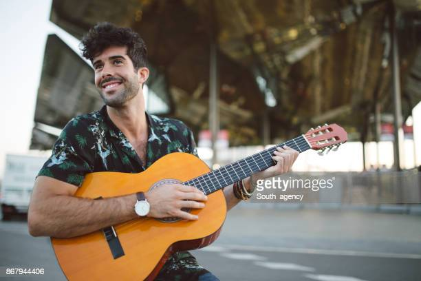 street guitarist - busker stock pictures, royalty-free photos & images
