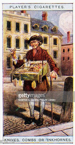 A street hawker in breeches and stockings a necktie cap and apron with a tray around his neck filled with his wares In his hand are a pair of...