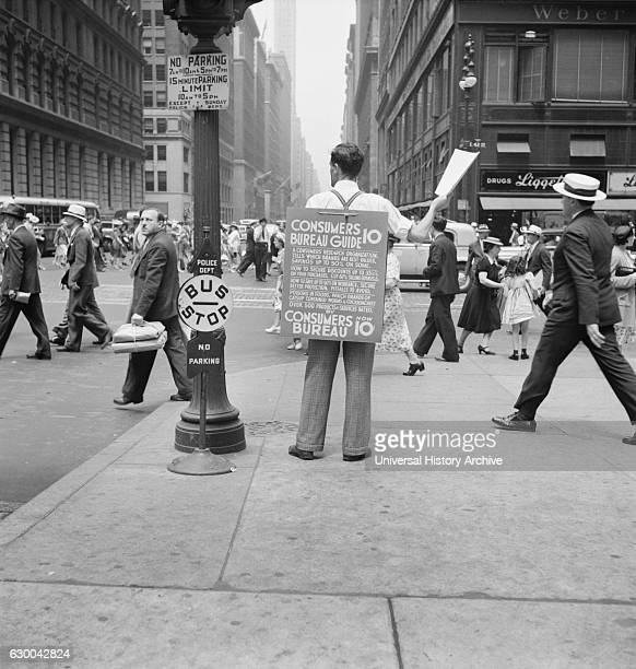 Street Hawker Selling Consumer's Bureau Guide 42nd Street and Madison Avenue New York City New York USA Dorothea Lange for Farm Security...