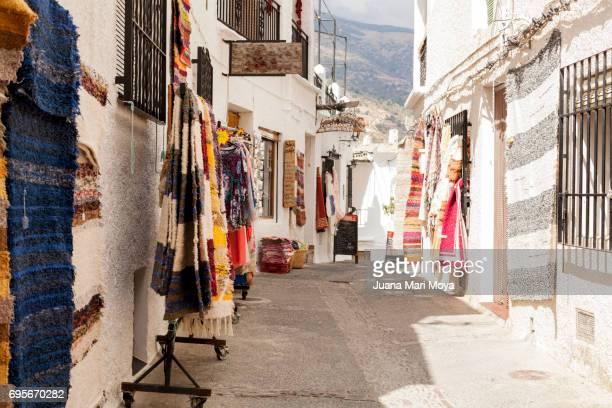 a street in alpujarra, granada - granada stock photos and pictures