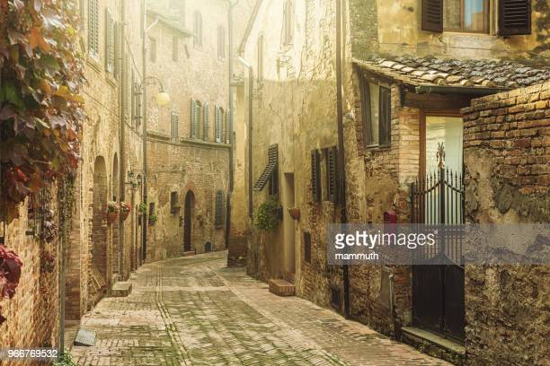 street in an old italian town in tuscany - villaggio foto e immagini stock