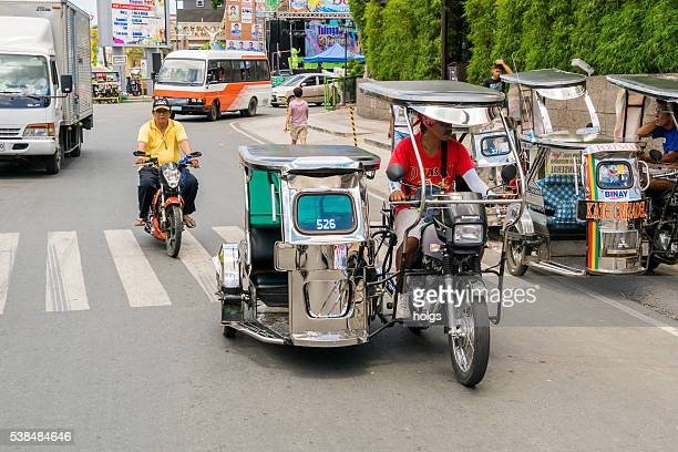 street in batangas, philippines - tricycle stock pictures, royalty-free photos & images