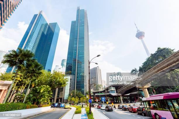 street in downtown of kuala lumpur, malaysia - menara kuala lumpur tower stock photos and pictures