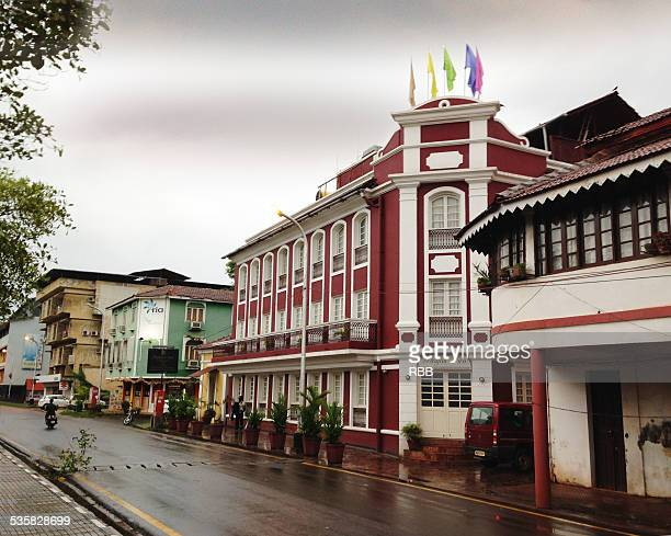 street in front of old patto bridge goa - panjim stock photos and pictures