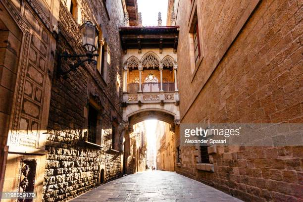street in gothic quarter in barcelona, spain - barcelona spain stock pictures, royalty-free photos & images