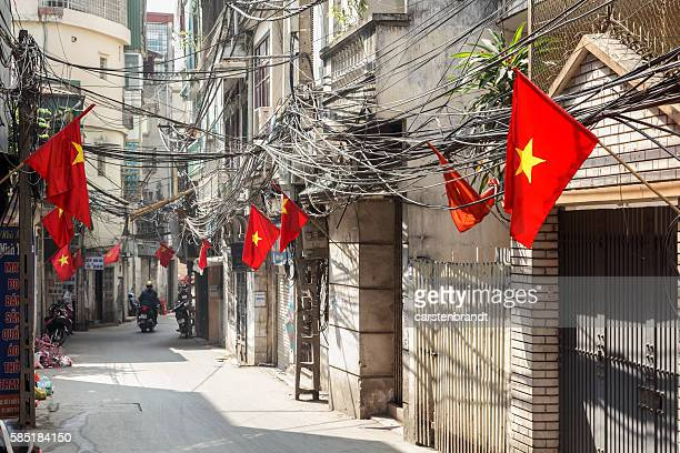 Street in Hanoi with flags and cables