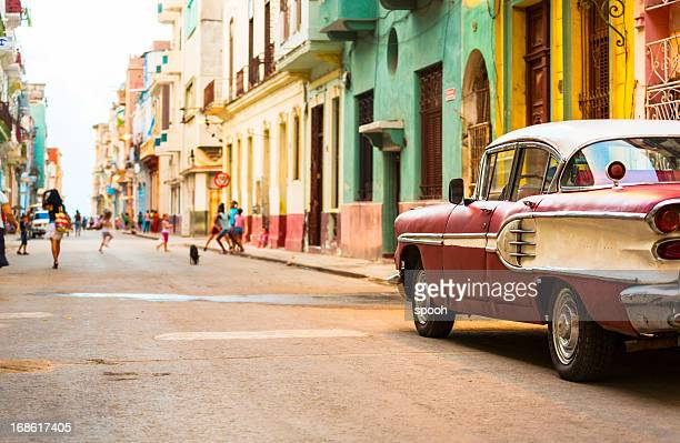 street in havana, cuba with vitage american car - caribbean culture stock pictures, royalty-free photos & images