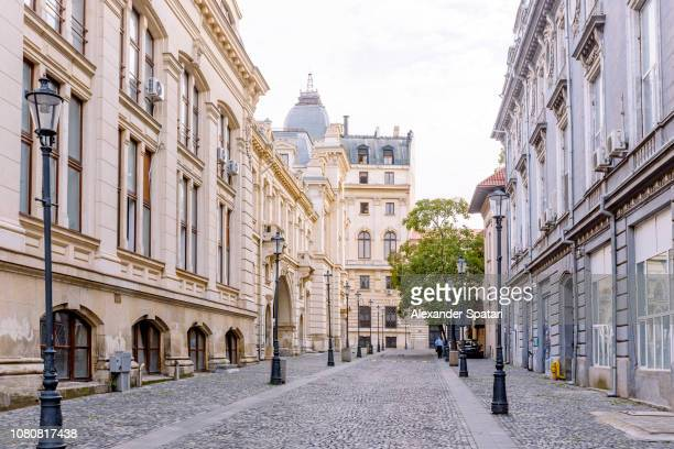 street in historical old town in bucharest, romania - bucharest stock pictures, royalty-free photos & images