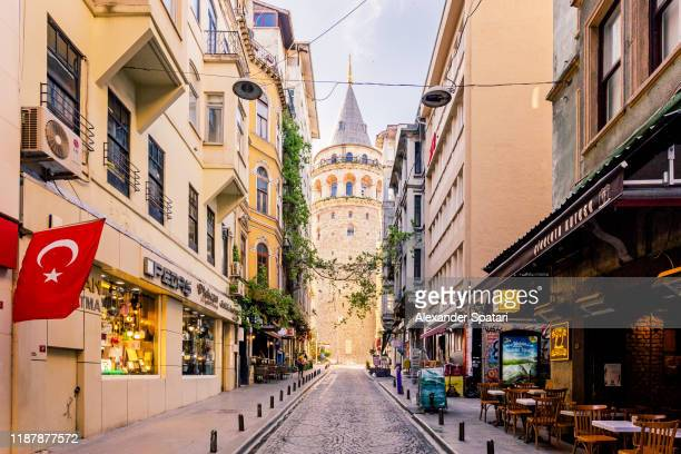 street in istanbul with galata tower in the center, turkey - turkey middle east stock pictures, royalty-free photos & images