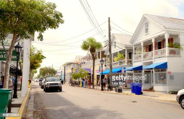 street in key west - duval street stock pictures, royalty-free photos & images