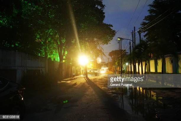 street in lagos at night - lagos stock pictures, royalty-free photos & images