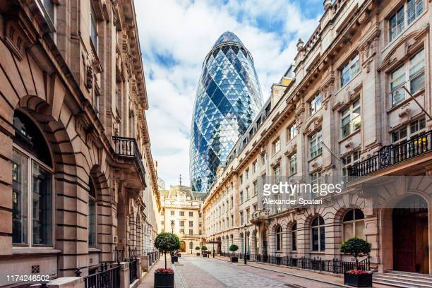 street in london with old historic houses and 'gherkin' skyscraper, england, uk - new stock pictures, royalty-free photos & images
