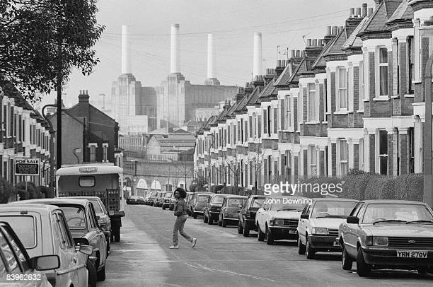 A street in London's Battersea with Battersea Power Station at the far end circa 1980