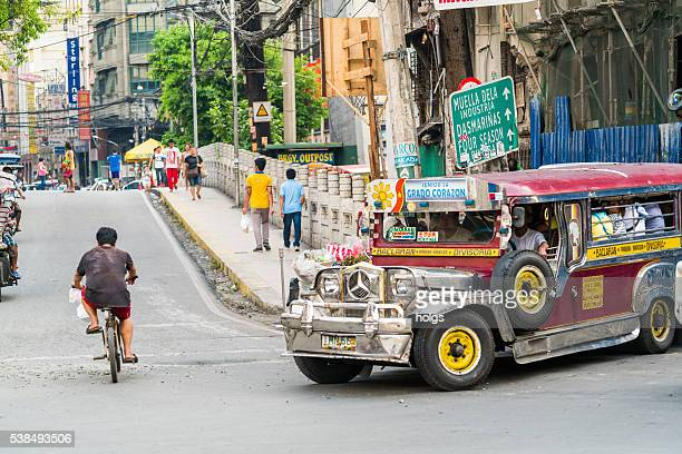 street in manila, philippines - jeepney stock pictures, royalty-free photos & images