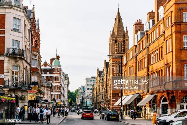 street in mayfair district on a sunny day, london, england, uk - central london stock pictures, royalty-free photos & images