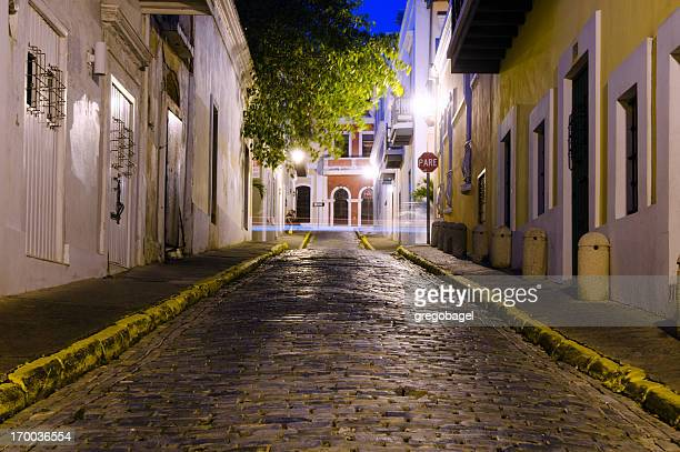 street in old san juan, puerto rico at night - san juan stock pictures, royalty-free photos & images