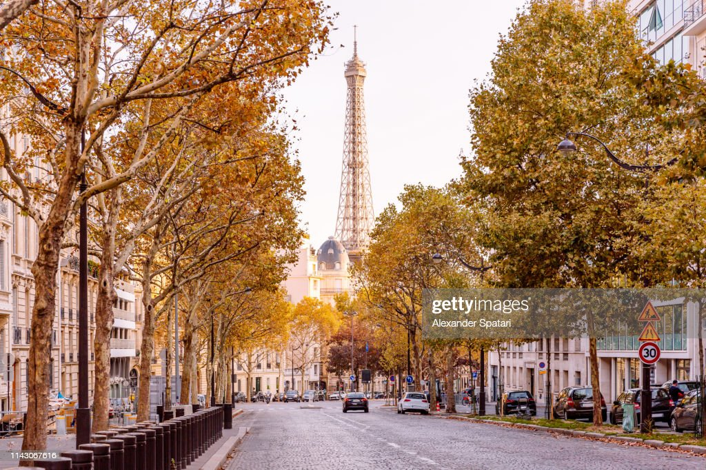 Street in Paris with Eiffel Towers and autumn trees, France : Stock Photo