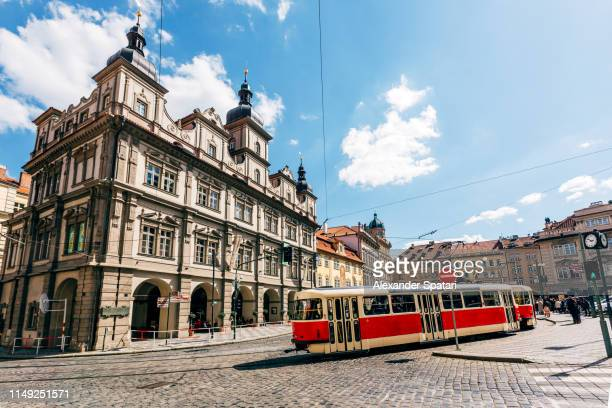 street in prague with red old tram, bohemia, czech republic - チェコ共和国 ストックフォトと画像