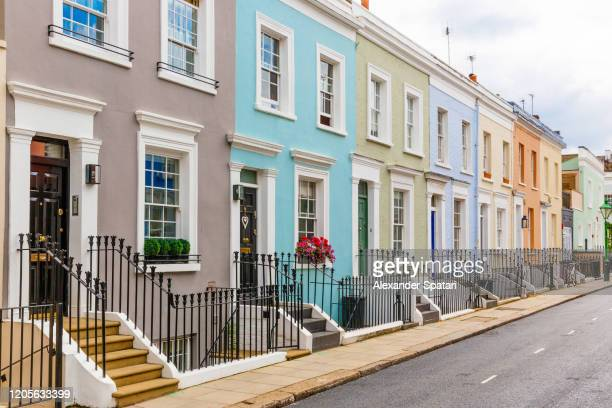 street in residential district with row houses in london, uk - english culture stock pictures, royalty-free photos & images