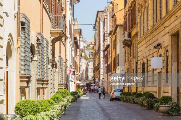 street in rome historical center on a sunny day, rome, italy - incidental people stock pictures, royalty-free photos & images