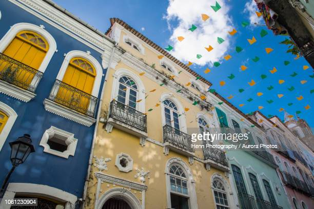 street in salvador decorated with colorful flags between buildings, salvador, bahia, brazil - bahia state stock pictures, royalty-free photos & images