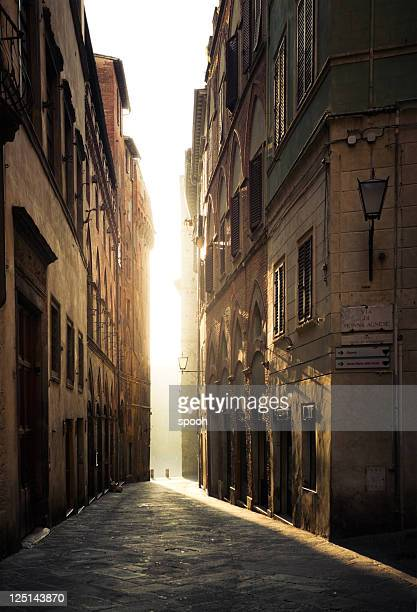 street in siena, italy - empty in a morning - narrow stock pictures, royalty-free photos & images