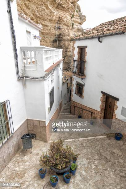 Street in spectacular village of Setenil de las Bodegas pierced in the rocks in the montain range of Cadiz, Andalusia, Spain.