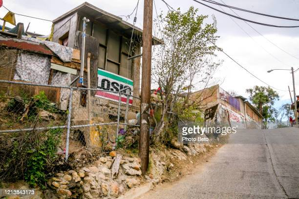 a street in the popular and poor district of lomas taurinas in north tijuana - mexico murder stock pictures, royalty-free photos & images