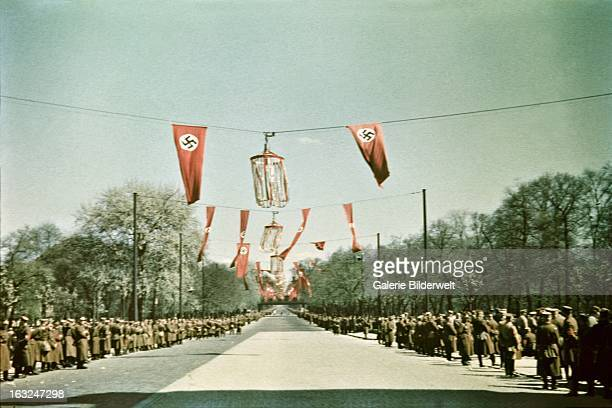 A street in the Tiergarten lined by police and SA forces 1st May 1937 At the Lustgarten Adolf Hitler chancellor of Germany delivered a speech in...