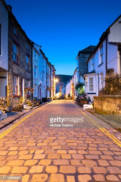 street in the village of staithes in yorkshire in the blue hour at night - street stock pictures, royalty-free photos & images
