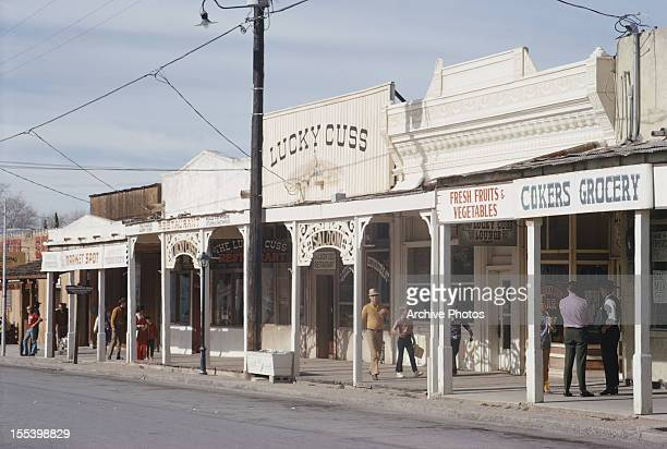Street in Tombstone, Arizona, boasting the Lucky Cuss and Cokers Grocery, December 1971.