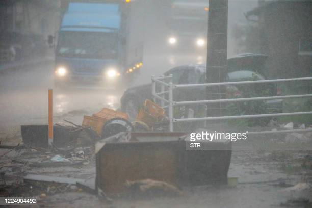 Street is covered by debris and mud in a flood affected area following torrential rain in Ashikita, Kumamoto prefecture on July 6, 2020. - At least...