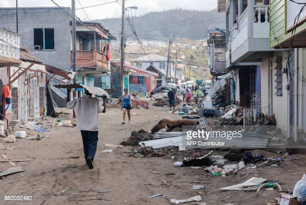A street is covered with debris September 22 2017 in Roseau capital of the Caribbean island of Dominica four days after the passage of Hurricane...