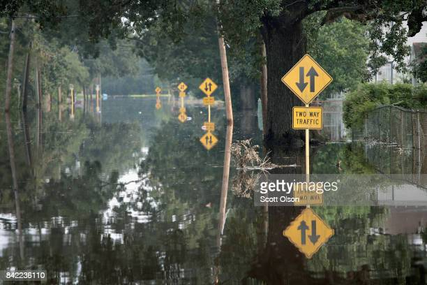 A street is covered with floodwater after torrential rains pounded Southeast Texas following Hurricane and Tropical Storm Harvey causing widespread...