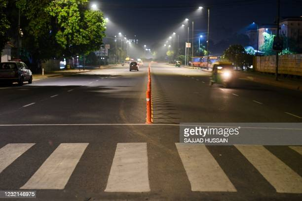 Street is pictured in New Delhi on April 6 as the Indian capital imposed a night curfew a day after the nation posted a record coronavirus surge,...